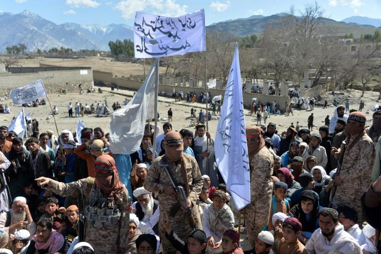 Afghan Taliban militants and villagers celebrate the peace deal with the US in early March 2020, but the insurgents have rejected the negotiators named by the government in Kabul