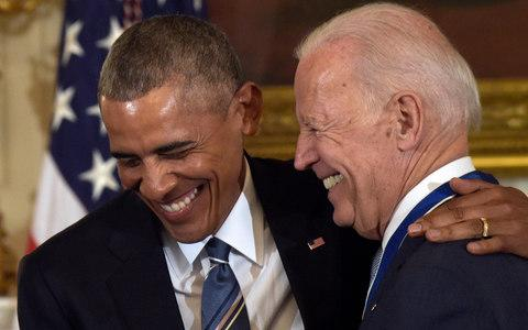 President Barack Obama shares a laugh with Vice President Joe Biden during a ceremony in the State Dining Room of the White House in Washington - Credit: AP Photo/Susan Walsh