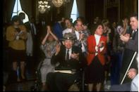 <p>People celebrate on Capitol Hill after the senate passes the Americans with Disabilities Act. </p>