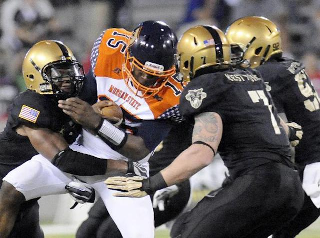 Army's defense sacks Morgan State's quarterback Robert Council (15) for a loss during the second half of an NCAA college football game Friday, Aug. 30, 2013, in West Point, N.Y. (AP Photo/Hans Pennink)