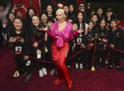 """Singer Christina Aguilera poses with students from the Wushu Action Star Academy martial arts school in Temple City, Calif., at the premiere of the film """"Mulan,"""" at the El Capitan Theatre, Monday, March 9, 2020, in Los Angeles. (AP Photo/Chris Pizzello)"""