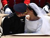 <p>During the royal procession to Windsor Castle following their royal wedding on 19 May 2018, Prince Harry couldn't help share a kiss with his bride en route, making this their second public royal kiss together since their wedding, May 2018. </p>