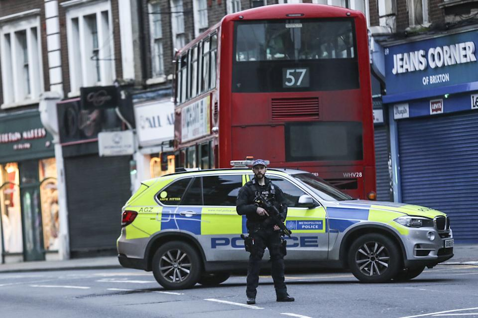 LONDON, UNITED KINGDOM - FEBRUARY 02: Police emergency services are seen at the site of an incident after a man has been shot dead by police in South London following stabbing several people at a street in Streatham, London, Britain on February 02, 2020.  London's Metropolitan Police said incident has been declared 'terrorist-related', shot man pronounced dead. (Photo by Ilyas Tayfun Salci/Anadolu Agency via Getty Images)