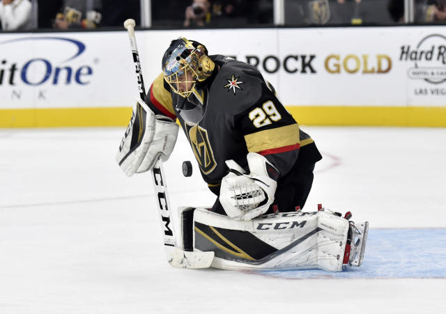 Vegas Golden Knights goaltender Marc-Andre Fleury stops a shot on goal against the Buffalo Sabres during the third period of an NHL hockey game, Tuesday, Oct. 16, 2018, in Las Vegas. (AP Photo/David Becker)