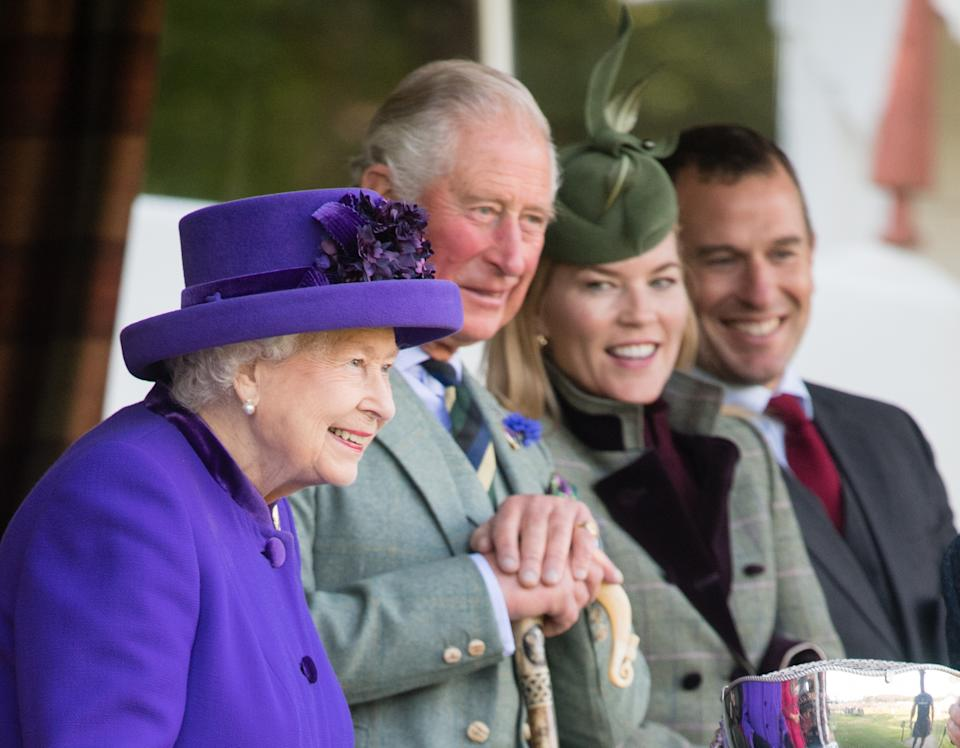 BRAEMAR, SCOTLAND - SEPTEMBER 07: Queen Elizabeth II, Prince Charles, Prince of Wales, Autumn Phillips and Peter Phillips attend the 2019 Braemar Highland Games  on September 07, 2019 in Braemar, Scotland. (Photo by Samir Hussein/WireImage)