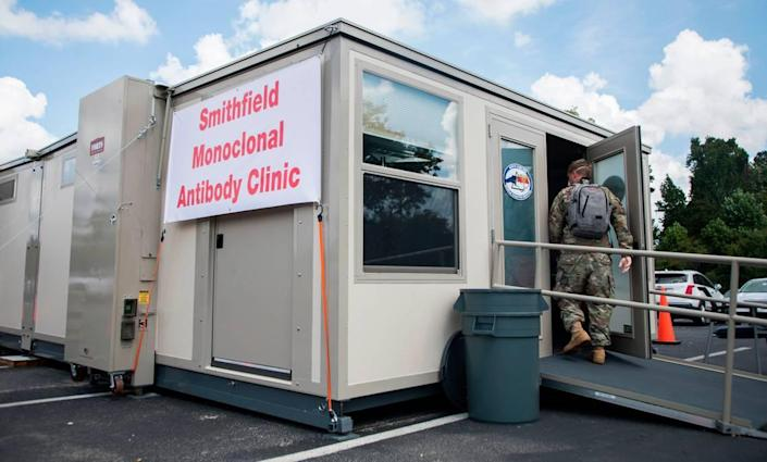 National Guard member Charles Eldridge enters a monoclonal antibody treatment clinic for people who are COVID-19 positive, located in the parking lot of the Johnston County Public Health Department in Smithfield, N.C. on Wednesday, Sept. 15, 2021.