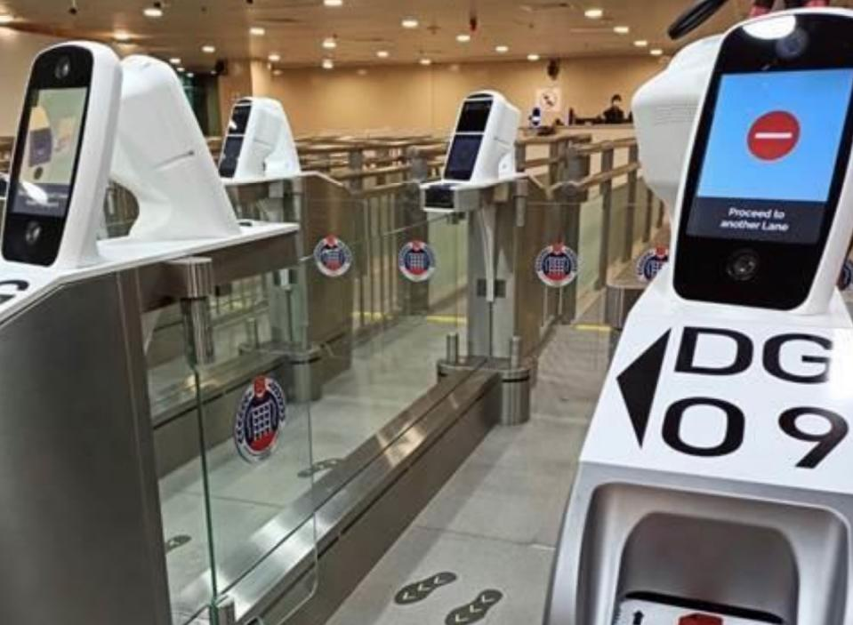 Iris and facial scanners at immigration checkpoints in Singapore.