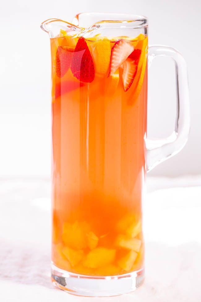 """<p>A sweet, citrusy punch that can be made even more patriotic by cutting the fruit into stars a la the sangria above. </p><p>Get the <a href=""""https://www.averiecooks.com/tropical-strawberry-lemonade-party-punch/"""" rel=""""nofollow noopener"""" target=""""_blank"""" data-ylk=""""slk:recipe"""" class=""""link rapid-noclick-resp"""">recipe</a>.</p>"""