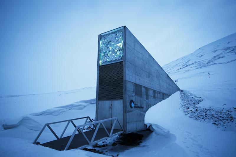 """FILE - This is a March 2. 2016 file photo of an exterior view of the Svalbard Global Seed Vault, the secure seed bank on Svalbard, Norway. Nearly 10 years after a """"doomsday"""" seed vault opened on an Arctic island off Norway, some 50,000 new samples from seed collections ranging from India, the Middle East, northern Africa and Europe to the U.S. and Mexico, have been deposited in the world's largest repository, built to safeguard against wars or natural disasters wiping out global food crops. (Heiko Junge/ NTB scanpix, File via AP)"""