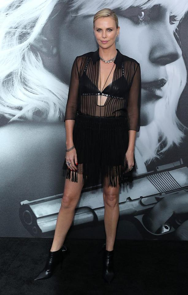 """<p>Charlize <a rel=""""nofollow"""" href=""""https://uk.style.yahoo.com/charlize-theron-just-wore-bra-red-carpet-145647593.html"""">swapped her white Dior bra</a> for a black one, revealing it under a sheer black shirt and fringed skirt.<br /><i>[Photo: Getty]</i> </p>"""