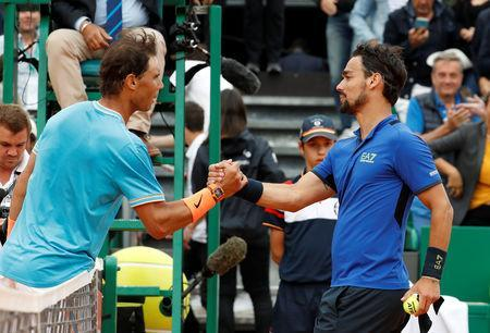 Tennis - ATP 1000 - Monte Carlo Masters - Monte-Carlo Country Club, Roquebrune-Cap-Martin, France - April 20, 2019 Italy's Fabio Fognini shakes hands with Spain's Rafael Nadal after their semi final match REUTERS/Eric Gaillard
