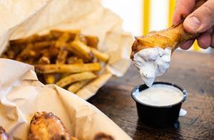 Pit-Smoked wings and hand cut fries, available now for dine in or carry out at Wing Boss