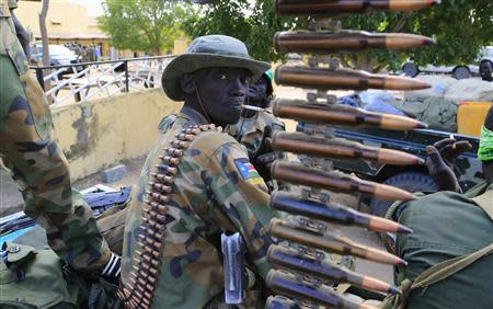 South Sudan army soldier stands next to a machine gun mounted on a truck in Malakal