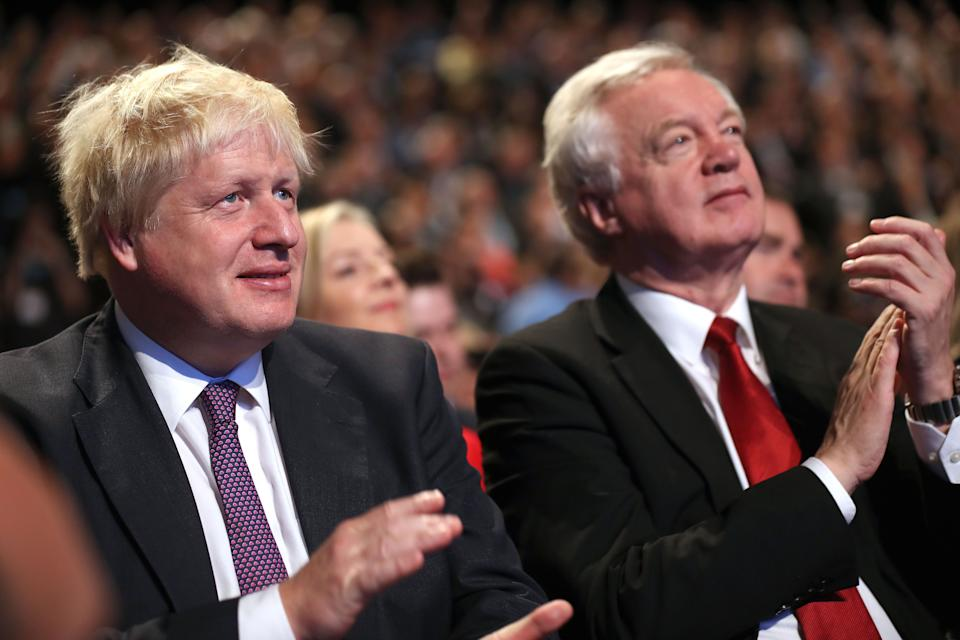 "Foreign Secretary Boris Johnson and Brexit Secretary David Davis await the arrival of Prime Minister Theresa May before she delivers her keynote speech to delegates and party members on the last day of the Conservative Party Conference at Manchester Central on October 4, 2017 in Manchester, England. The prime minister rallied members and called for the party to ""shape up"" and ""go forward together"". Theresa May also announced a major programme to build council houses and a cap on energy prices.  (Photo by Christopher Furlong/Getty Images)"