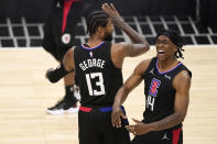 Los Angeles Clippers guard Terance Mann, right, celebrates with guard Paul George after scoring and drawing a foul during the first half in Game 4 of a second-round NBA basketball playoff series against the Utah Jazz Monday, June 14, 2021, in Los Angeles. (AP Photo/Mark J. Terrill)