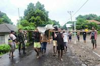Indonesia's disaster management agency said it had recorded 130 deaths in a cluster of remote islands near East Timor, where another 27 have been officially listed as dead