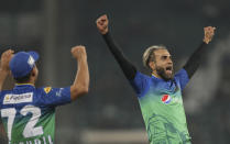Imran Tahir of Multan Sultans celebrates after claiming the wicket of Lahore Qalandars' Mohammad Hafeez in the Pakistan Super League match in Lahore, Pakistan, Friday, Feb. 21, 2020. (AP Photo/K.M. Chaudhry)