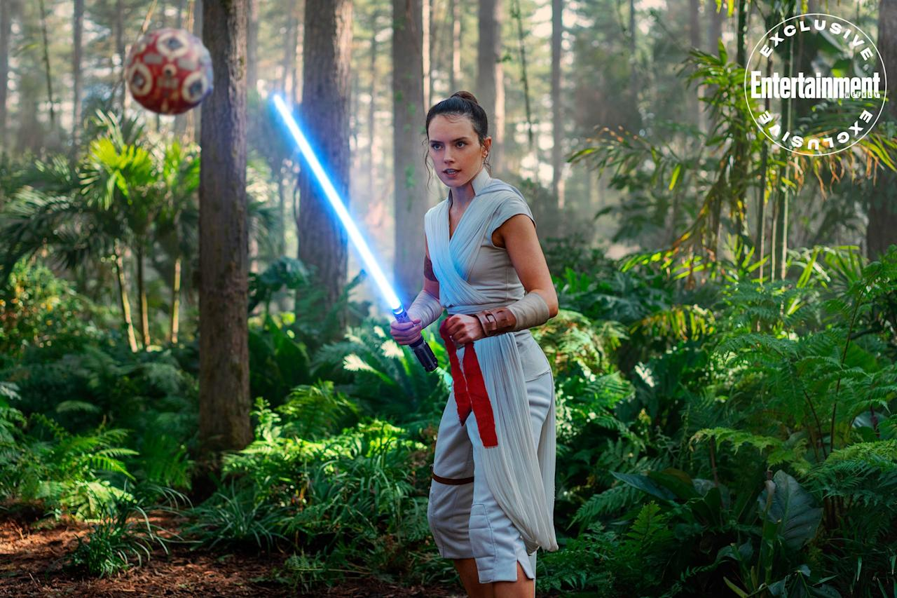 "Rey (<a href=""https://ew.com/tag/daisy-ridley/"">Daisy Ridley</a>) faces off against a training remote."