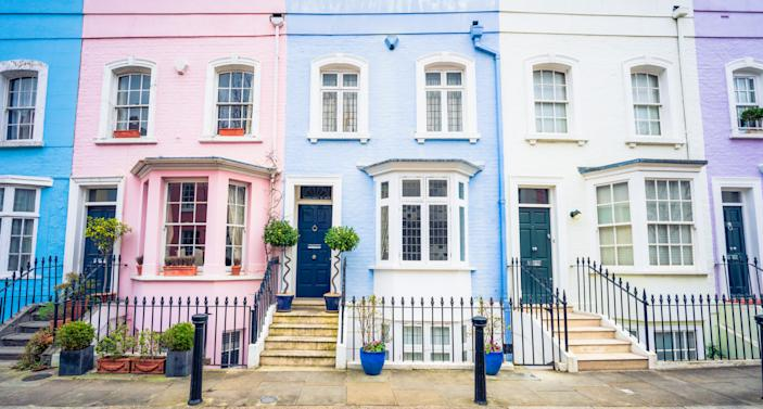 A row of multi-coloured townhouses in London's Kensington and Chelsea district.