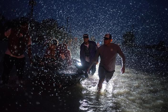 <p>Samaritans help push a boat with evacuees to high ground during a rain storm caused by Tropical Storm Harvey along Tidwell Road in east Houston, Texas, Aug. 28, 2017. (Photo: Adrees Latif/Reuters) </p>