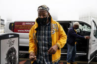 "First time voter, Gary Ragland, 64, of East Point, Ga., arrives to State Farm Arena in a van provided by NACA for an event called ""Roll to the Polls"" to vote early on Wednesday, Oct. 28, 2020, in Atlanta. (AP Photo/Brynn Anderson)"