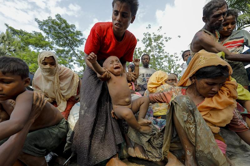 Rohingya refugees arrive at a makeshift new camp in Unchiprang in Bangladesh (AFP Photo/K M ASAD)