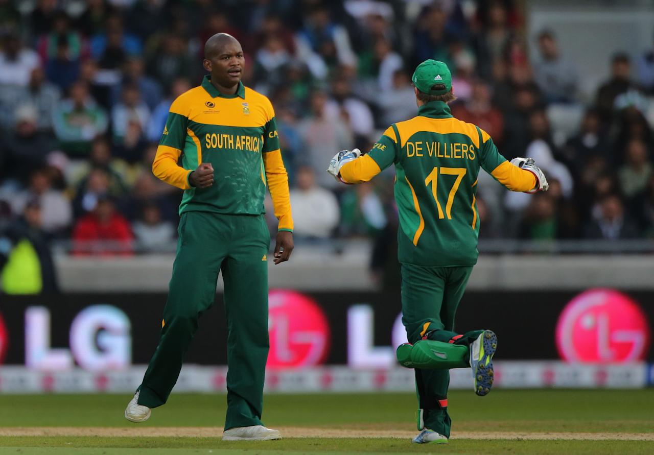 South Africa's bowler Lonwabo Tsotsobe celebrates with captain AB de Villiers after taking the wicket of Pakistan batsman Misbah during the ICC Champions Trophy match at Edgbaston, Birmingham.