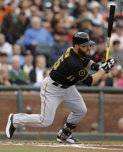 Pittsburgh Pirates' Russell Martin swings for an RBI single off San Francisco Giants' Madison Bumgarner in the first inning of a baseball game Monday, July 28, 2014, in San Francisco. (AP Photo/Ben Margot)
