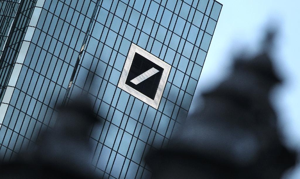 Despite Frankfurt being down overall, Deutsche Bank shares firmed 0.6 percent to 13.38 euros after the troubled German lender posted a surprise third-quarter net profit (AFP Photo/Daniel Roland)