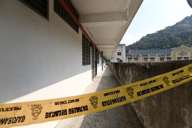 The corridor leading to the crime scene is cordoned off by police tape in Paya Terubong, George Town March 14, 2018. — Picture by Sayuti Zainudin