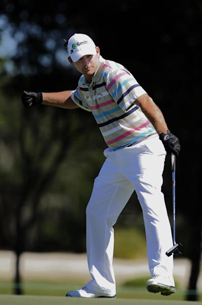 Tommy Gainey reacts after hitting a birdie putt on the 16th green during the final round of the McGladrey Classic PGA Tour golf tournament Sunday, Oct. 21, 2012 in St. Simons Island, Ga. (AP Photo/Stephen Morton)