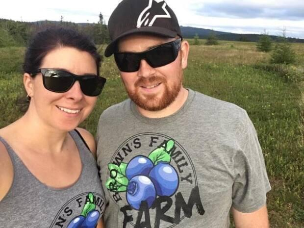 Nancy White, left, co-owner of Brown's Family Farm with Justin Brown, right, says up to 3,000 lbs of berries may have been stolen. (Submitted by Nancy White - image credit)