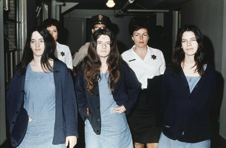 why charles manson s brainwashed golden girl probably won t go  van houten on the far right appeared happy throughout her trial unless someone in the courtroom spoke ill of charles manson