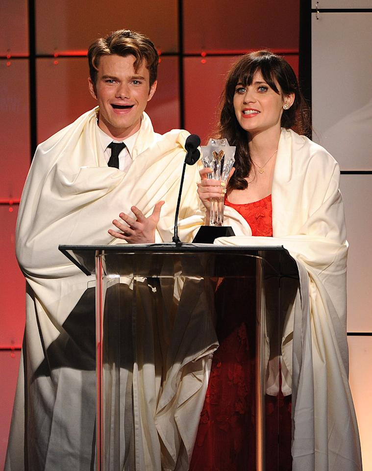 "Apparently, the Beverly Hilton was a bit chilly when the Second Annual Critics' Choice Awards took place. ""Glee"" guy Chris Colfer and ""New Girl"" Zooey Deschanel wrapped themselves in tablecloths when they took the stage to present an award. We're still not exactly sure why ... (6/18/2012)"