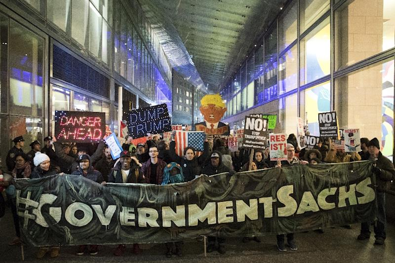 Activists rally against plans to loosen Wall Street regulations and repeal the Dodd-Frank Act outside of Goldman Sachs headquarters New York on February 7, 2017