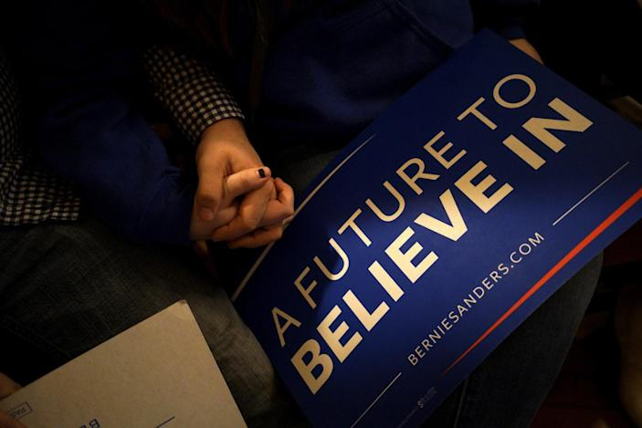 <p>People hold hands at a campaign rally for Bernie Sanders in Claremont, N.H., Feb. 2, 2016. <i>(Photo: Rick Wilking/Reuters)</i></p>