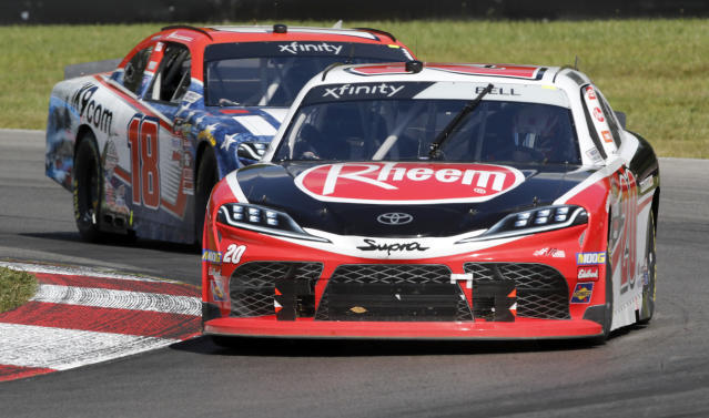 Christopher Bell (20) leads Jack Hawksworth (18) through a corner during a NASCAR Xfinity Series auto race, Saturday, Aug. 10, 2019, at Mid-Ohio Sports Car Course in Lexington, Ohio. (AP Photo/Tom E. Puskar)