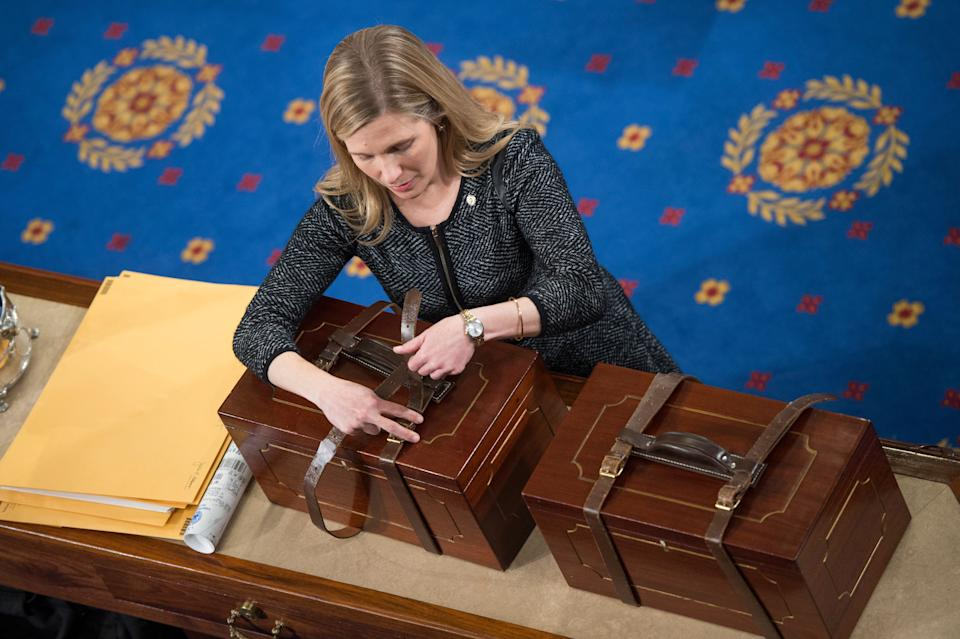 An aide opens Electoral College ballot boxes during a joint session of Congress to tally ballots for the president and vice president of the United States in January 2017. (Photo: Tom Williams via Getty Images)