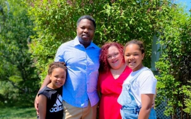 Kassim Doumbia has lived in Shippagan for 14 years with his wife, Karine Doumbia, who's from the region. Together, they have two daughters, Mawa, left, and Mariam, right.
