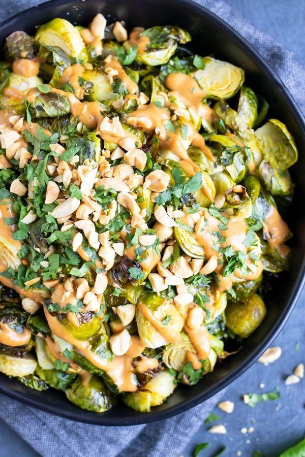 """<p>A creamy, indulgent side that happens to be vegan? Sign us up! You'll want to eat the spicy peanut butter sauce by the spoonful. </p><p><strong>Get the recipe from <a href=""""https://www.evolvingtable.com/peanut-butter-sriracha-brussels-sprouts/"""" rel=""""nofollow noopener"""" target=""""_blank"""" data-ylk=""""slk:Evolving Table"""" class=""""link rapid-noclick-resp"""">Evolving Table</a>.</strong></p>"""