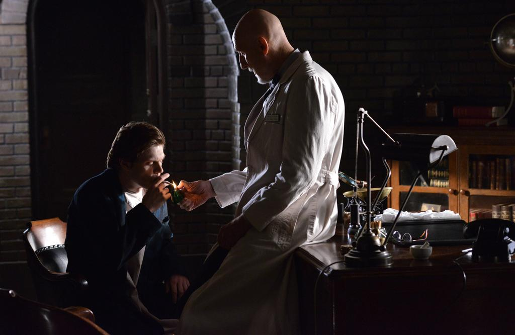 "Joseph Cromwell as Dr. Arthur Arden and Evan Peters as Kit Walker in the ""American Horror Story: Asylum"" episode, ""The Coat Hanger."""