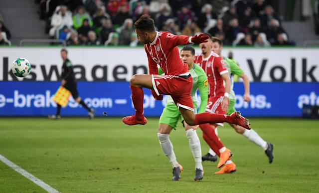 Soccer Football - Bundesliga - VfL Wolfsburg vs Bayern Munich - Volkswagen Arena, Wolfsburg, Germany - February 17, 2018 Bayern Munich's Corentin Tolisso shoots at goal REUTERS/Fabian Bimmer DFL RULES TO LIMIT THE ONLINE USAGE DURING MATCH TIME TO 15 PICTURES PER GAME. IMAGE SEQUENCES TO SIMULATE VIDEO IS NOT ALLOWED AT ANY TIME. FOR FURTHER QUERIES PLEASE CONTACT DFL DIRECTLY AT + 49 69 650050