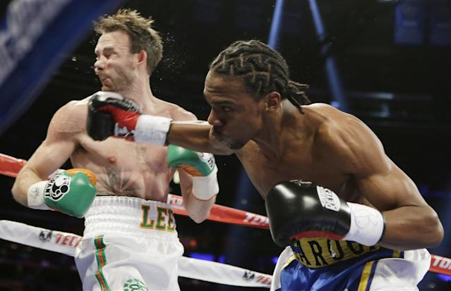 John Jackson, of St. Thomas, Virgin Islands, knocks down Andy Lee, of Ireland, during the first round of a NABF Super Welterweight Title boxing match Saturday, June 7, 2014, in New York. Lee won the fight with a knockout during the first fifth round. (AP Photo/Frank Franklin II)