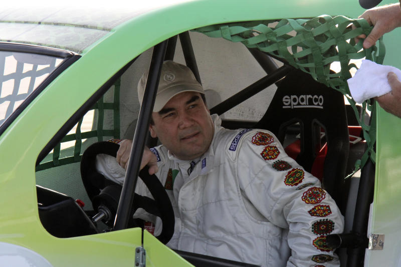 Turkmenistan's President Gurbanguli Berdymukhamedov sits in a Volkicar after winning a car race in Ashgabat, Turkmenistan, Saturday, April 7, 2012. Turkmenistan's authoritarian leader has proven he doesn't only win elections easily, coming first in a car race he wasn't even supposed to take part in. He drove to the racing track in a Bugatti sports car then the president changed into racing gear, entered the zippy and diminutive Turkish-made Volkicar automobile and promptly proceeded to record the best time in the time-trial challenge. Announcers at the race said the winning car will be given to the national sports museum. (AP Photo)