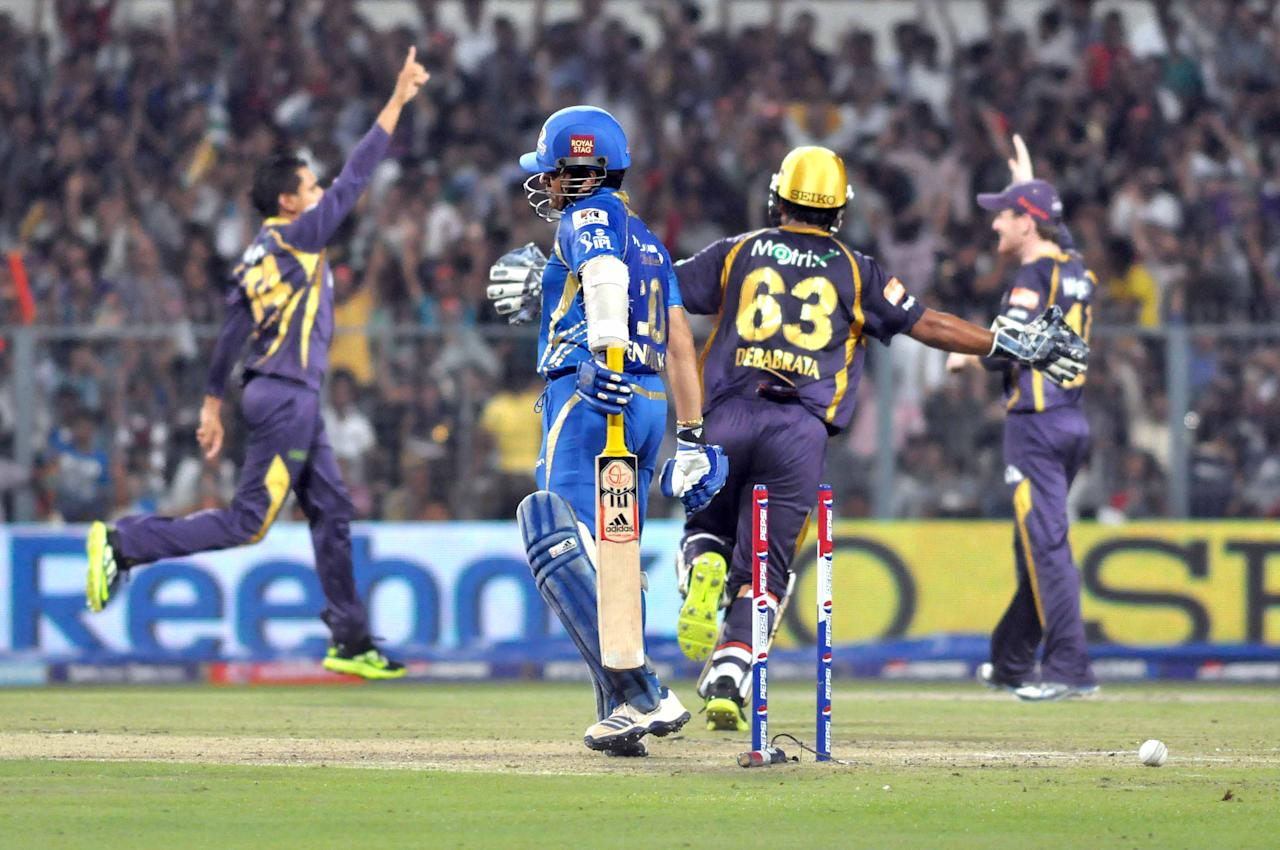 Mumbai Indians player Sachin Tendulkar gets bowled out by Sunil Narine during the match between Kolkata Knight Riders and Mumbai Indians at Eden Gardens in Kolkata on April 24, 2013. (Photo: IANS)