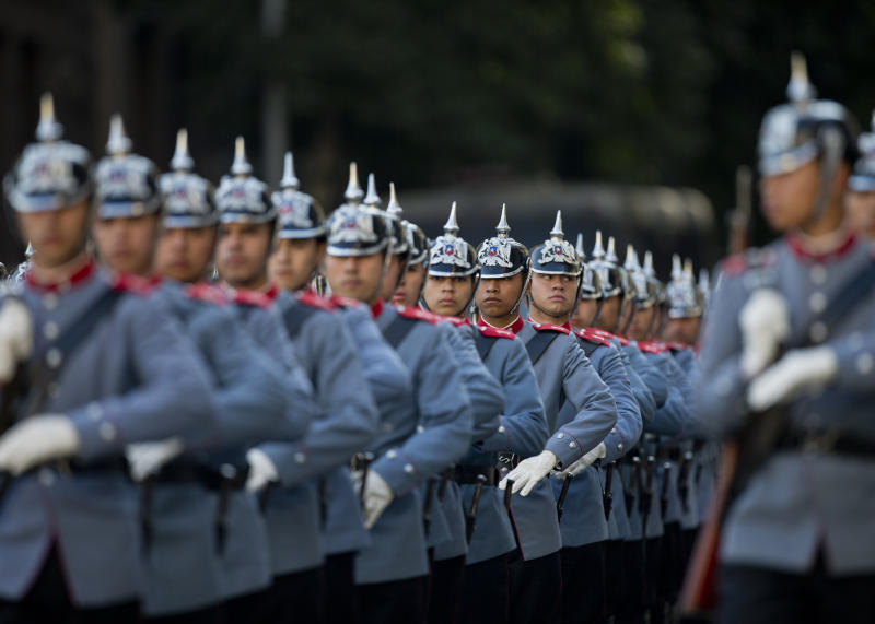 "Chile's ""Granaderos"" presidential guard prepare for the welcoming ceremony for Brazilian President Jair Bolsonaro at La Moneda, in Santiago, Chile, Saturday, March 23, 2019. Bolsonaro is on the last day of his two-day visit. (AP Photo/Esteban Felix)"