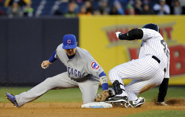 New York Yankees' Carlos Beltran, right, slides into second with a double as Chicago Cubs' Darwin Barney applies the late tag during the first inning of Game 2 of an interleague baseball doubleheader on Wednesday, April 16, 2014, at Yankee Stadium in New York. (AP Photo/Bill Kostroun)