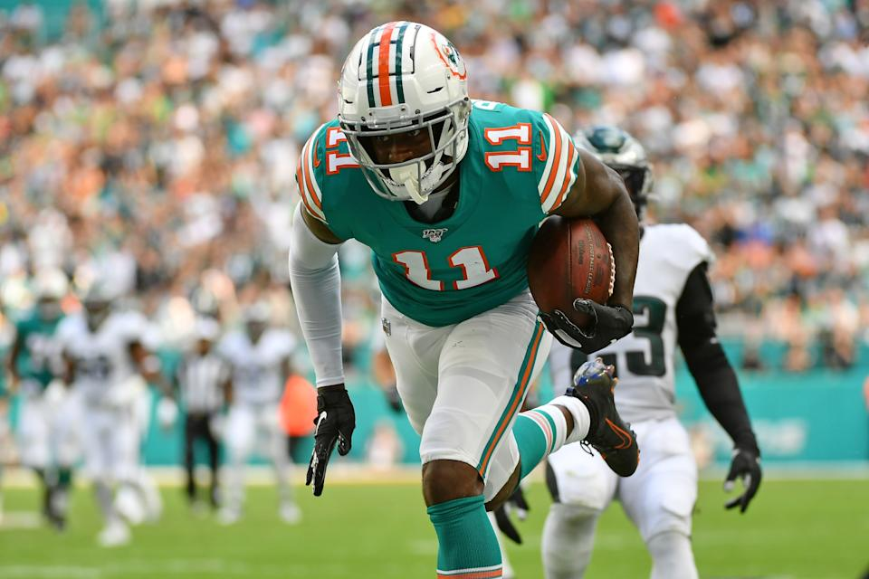 Dec 1, 2019; Miami Gardens, FL, USA; Miami Dolphins wide receiver DeVante Parker (11) runs for a touchdown against the Philadelphia Eagles during the first half at Hard Rock Stadium. Mandatory Credit: Jasen Vinlove-USA TODAY Sports