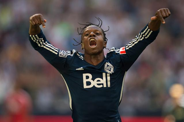 Vancouver Whitecaps' Darren Mattocks, of Jamaica, celebrates after scoring against FC Dallas during the first half of an MLS soccer game in Vancouver, British Columbia, on Sunday July 27, 2014.(AP Photo/The Canadian Press, Darryl Dyck)