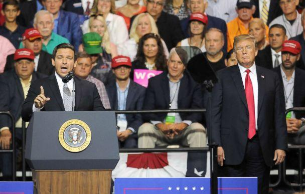 PHOTO: President Donald Trump listens to U.S. Rep. Ron DeSantis as he asks for the support of Trump voters in his bid to become Florida's next governor at a Make America Great Again Rally, July 31, 2018, at the Florida State Fairgrounds in Tampa, Fla. (Paul Hennessy/Polaris)
